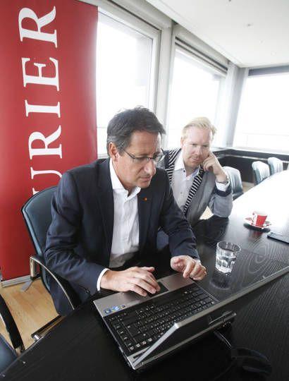 Josef Bucher (BZÖ) im KURIER-Wahlchat mit Pressesprecher Heimo Lepuschitz, 23.9.2013. Foto: Gerhard Deutsch