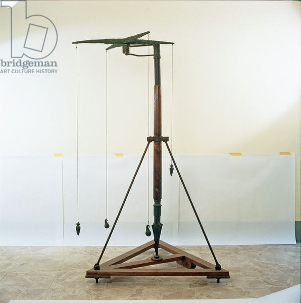 "Reconstruction of a Roman Groma. The Groma or gruma (altered from Greek gnomon ""indicator"", possibly through Etruscan) was the principal Roman surveying instrument. It comprised a vertical staff with horizontal cross-pieces mounted at right-angles on a bracket. Each cross piece had a plumb line hanging vertically at each end. It was used to survey straight lines and right-angles, thence squares or rectangles."