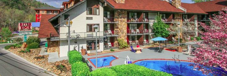 A photograph of the River Edge Motor Lodge, a popular downtown Gatlinburg hotel with a pool.