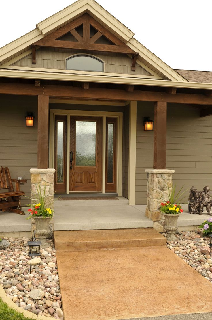 Landscaping in Front of House  http://www.jgdevelopment.com/photo-gallery/jggallery/natural-element-homes/natural-element-home-with-timber-accents
