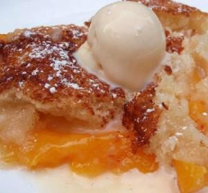 Southern Peach Cobbler Ingredients Ingredients 1/2 cup unsalted butter 1 cup all-purpose flour 2 cups sugar, divided 1 tablespoon baking powder Pinch of salt 1 cup milk 4 cups fresh peach slices 1 tablespoon lemon juice Ground cinnamon or nutmeg (optional)