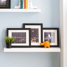 When you have a blank wall in your home, it can be intimidating. What do you put on it to fill the space? A practical and stylish option is to add a shelf or set shelves. By itself, the shelf serves as a beautiful accent piece for the room, but when you add picture frames, collectibles, and even a living décor piece like succulents to the shelf, you've created a whole new look. If you're considering adding shelving to your living room, bedroom, office, or bathroom, you've come to the right…