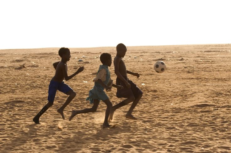 """UNICEF said; """"In refugee camps, children often play barefoot on any open stretch of dirt they can find."""""""