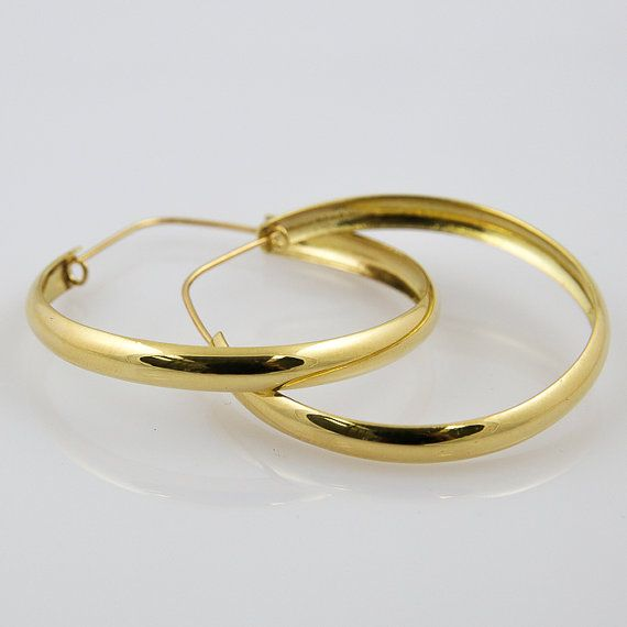 Check out this item in my Etsy shop https://www.etsy.com/listing/185260058/bold-retro-18k-yellow-gold-hoop-earrings