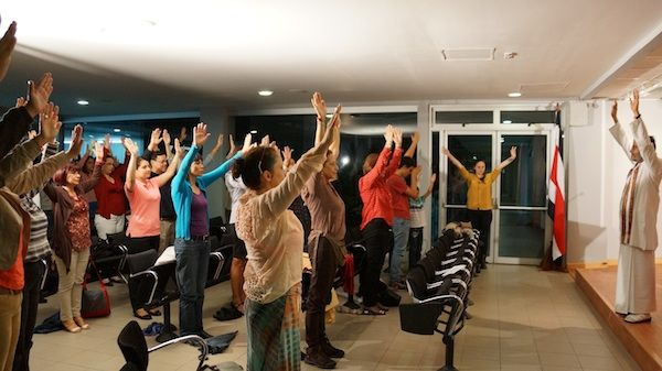 Students learning stress reduction stretches at National University in Costa Rica 2014