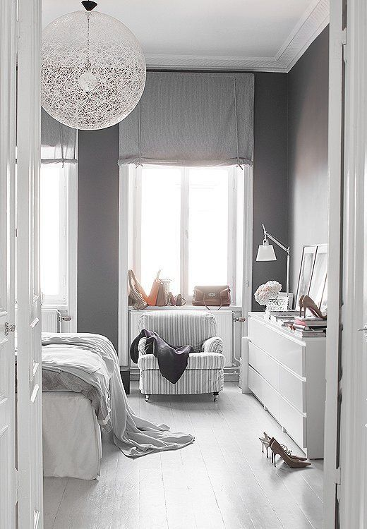 A soothing swath of gray paint and a pair of coordinating throws add depth to this otherwise all-white room.
