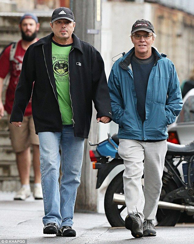 Out and about: Actors Christopher Knight and Mike Lookinland were spotted on Thursday enjo...