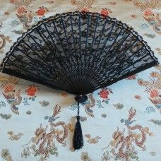 Fan: European Style - Black Lace.  The folding fan as we know them today originated in China and Japan 3000 years ago and were picked up by traders to sell to European countries. The Chinese and Japanese cultures created art forms with the fan; dance, opera, ceremonies and social occasions. Highly skilled artist from China and Japan hand paint on wood and paper to create modern fans in the traditional designs.  Bamboo and lace, made in China.   Height 23cm – width 38cm. $13.00au.