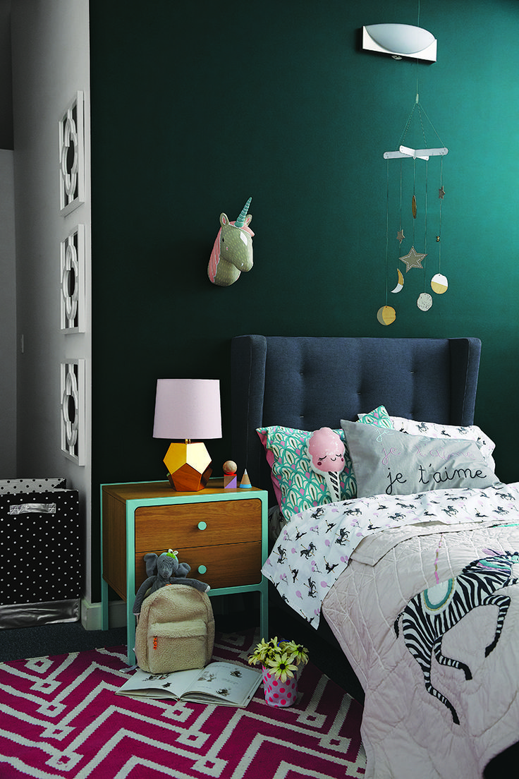 Deep, rich paint hues are popping up everywhere in interior design, so it was only a matter of time before they found their way into nurseries and kids rooms. #kidsroomdecor #kidsroomdarkwalls #darkgreywall