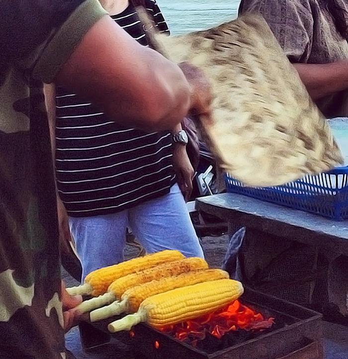 Frugal Taste: A street vendor roasting some corns for hungry passerby. (Photo by Electra Gillies).