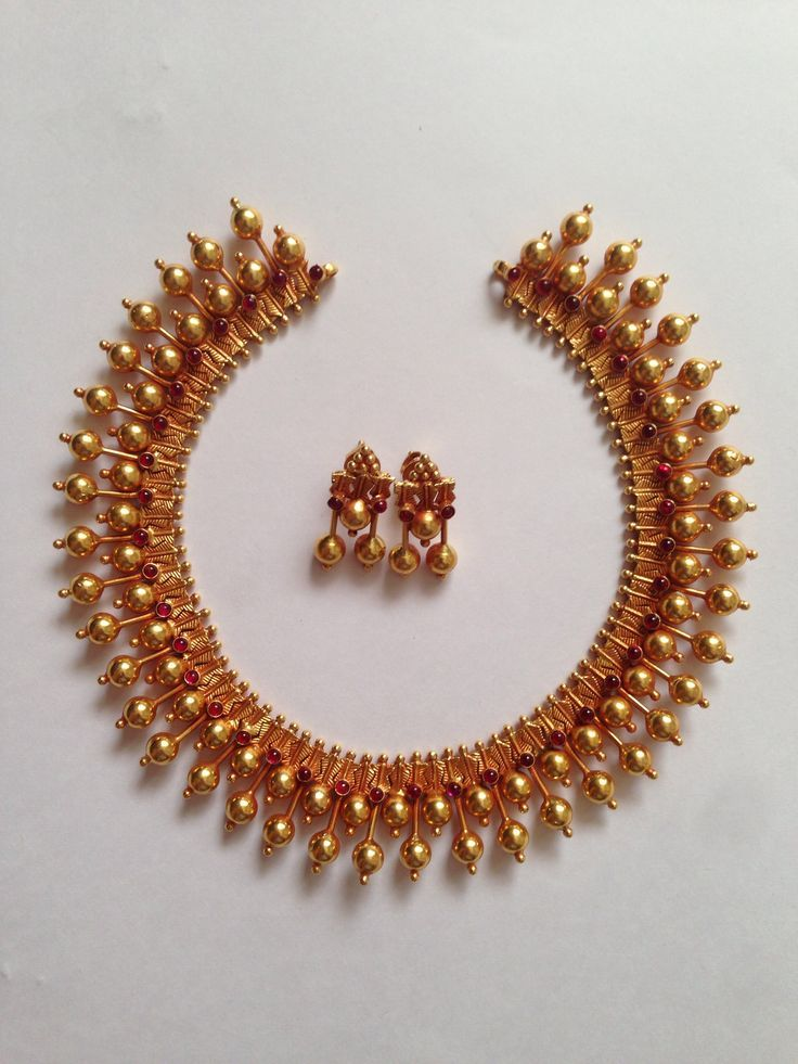 Short Necklace with gold beads and rubies. Gold Beads are in 2 rows with rubies studded in between.