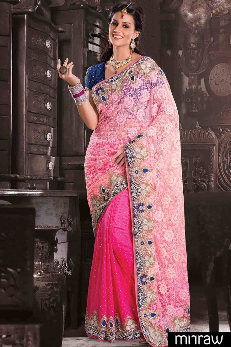 Latest Pink Georgette & Net saree in Weaved & stone work & blue velvet border & blue weaved blouse along with pink weaved & stone worked pallu to give you a pretty look