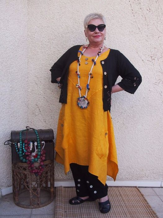 Gold tunic with black pants and narrow cardigan