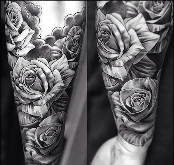 A half-sleeve tattoo with a lot of roses. Style: Black and Gray. Color: Gray