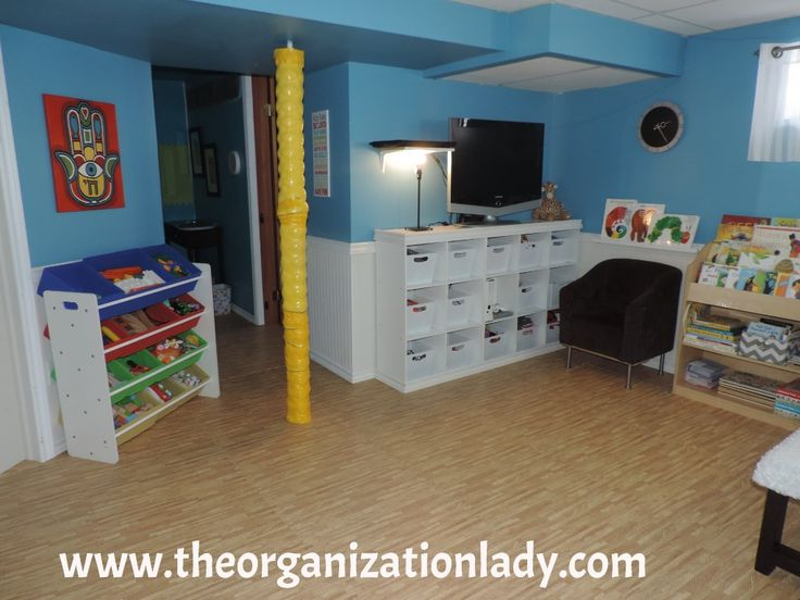 The open bin shelving to the left purchased at Canadian Tire is perfect for housing building toys. Children can easily see and reach what is inside without having to remove the bins (although they can if they want to!), making clean-up a snap! Cube storage with bins is great for those items you would like to have out of sight. Plastic bins from Dollerama were chosen over fabric ones as they are inexpensive and easy to clean after being grabbed by sticky hands!