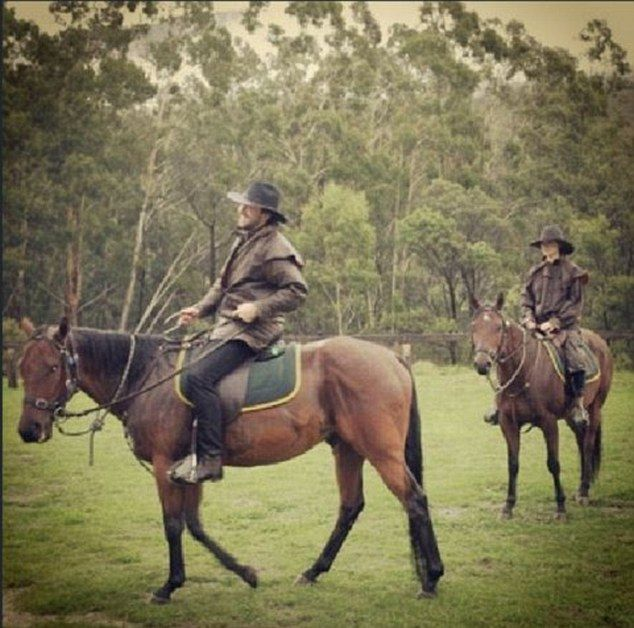'Beauty and the beast': Darren McMullen shared this photo horseriding with girlfriend Crystal Reed on Tuesday
