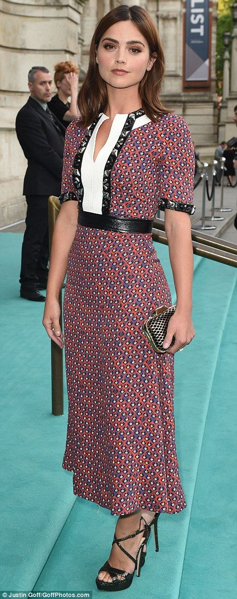 Figure-flaunting fashion: Jenna Coleman arrived in a quirky scarlet and lilac checked numb...