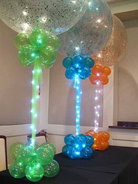Colored sparkle balloon centerpiece green blue orange