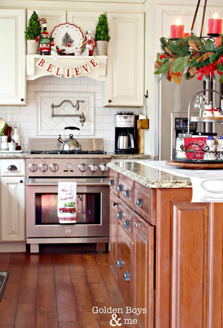 Christmas kitchen decor - Christmas Decor In Kitchen With Diy Mantel Hood And Candle Chandelier Over Island Www