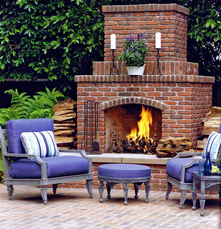 Antique Brick Used In This Elegant Fireplace Which Is Complimented By Blue Cushion Furniture