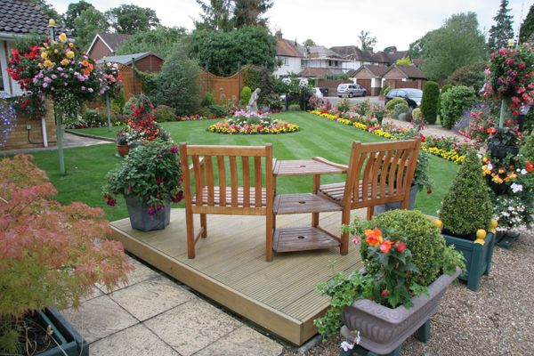 Sitting area decorating ideas garden landscape for Garden design decking areas