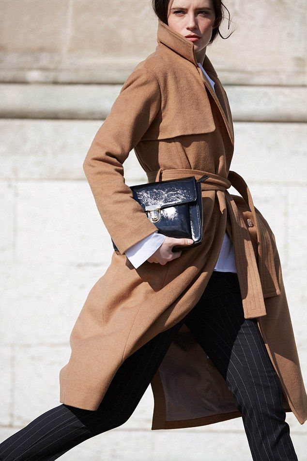 This winter season feels a bit different, a bit familiar - certainly to anyone over the age of 40 (Wool blend belted coat, £155, peg trousers, £49, and satchel bag, £39, all laredoute.co.uk)