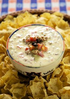 Spicy Queso Dip - 4 ingredients! sausage, cheese dip, black beans and Rotel - so good! I could make a meal out of this dip!! Great for NFL playoffs and the College National Championship Game.