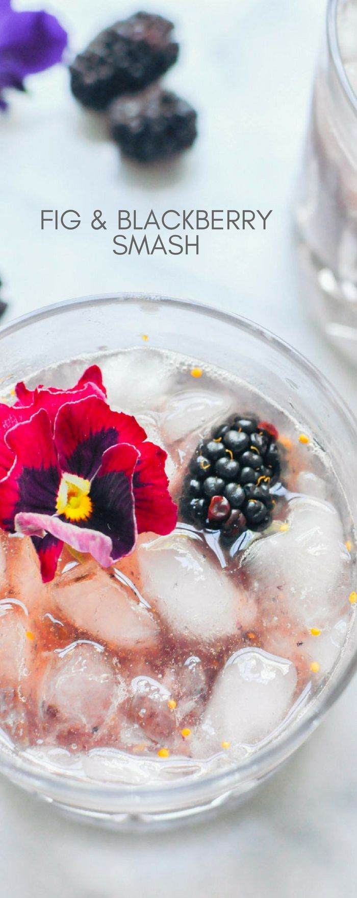 Do you need a happy hour cocktail recipe? This fig and blackberry smash is delicious! It has simple syrup, blackberries, a fig, bourbon, and crushed ice. Bonus if you add edible flowers!