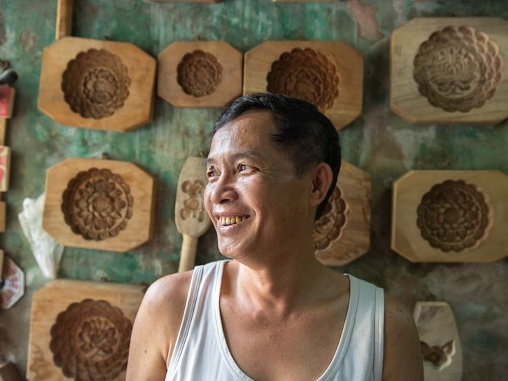 Craftsman Phan Van Quang was born into a wood carver's family, originally from the village of Dong Ky. He now sells his beautifully carved cookie molds on Hang Quat Street in the Old Quarter, but they are made about 8 miles from Hanoi in a family workshop in Dong Ky.