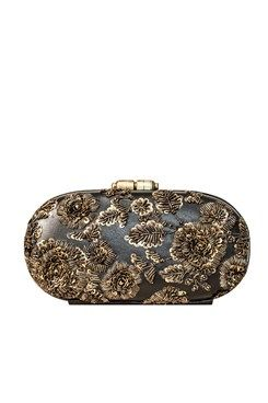 Clutches, Hand crusted all Leather minaudiere with handmade Nappa lining clutch eaturing a black oval box minaudiere clutch in nappa leather with zardosi hand crusted in floral pattern. It has round metal push lock on top and detachable sling chain Shop Now at www.carmaonlinesh... #carma #carmaonlineshop #LeatherZardoziCapsule #clutch #AccessoriesBySabyasachi #shopnow #onlineshopping