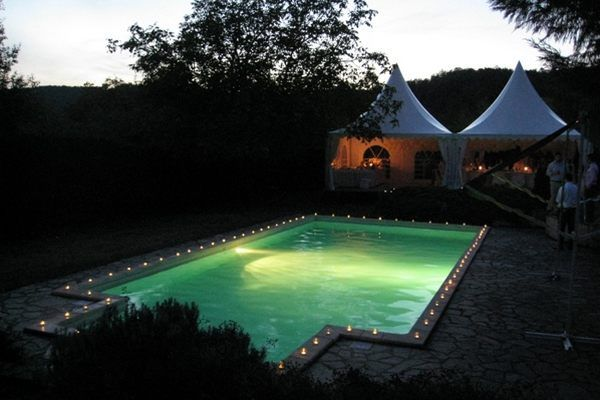 Image an evening reception around a lit swimming pool in the heart of South West France, Le Manoir des Granges, Dordogne