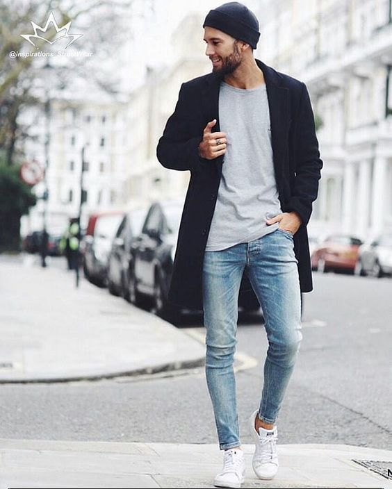 Choose a navy blue overcoat and baby blue skinny jeans to achieve a dressy but not too dressy look. Why not add white low top sneakers to the mix for a more relaxed feel?   Shop this look on Lookastic: https://lookastic.com/men/looks/overcoat-crew-neck-t-shirt-skinny-jeans/18235   — Navy Beanie  — Navy Overcoat  — Grey Crew-neck T-shirt  — Light Blue Skinny Jeans  — White Low Top Sneakers