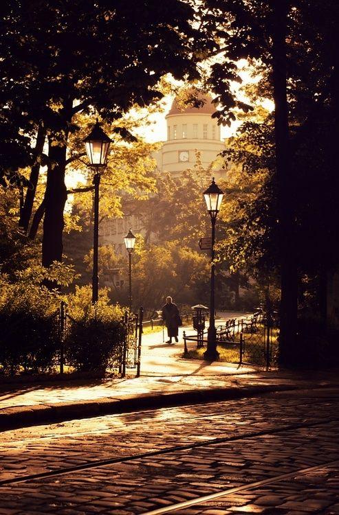 Poland, I love the lamps, cobblestone, and gates.
