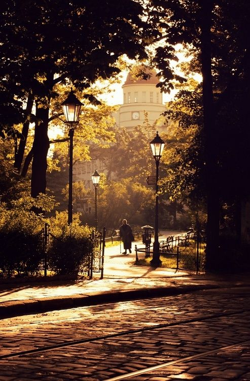 Poland, I love the lamps, cobblestone, and gates.