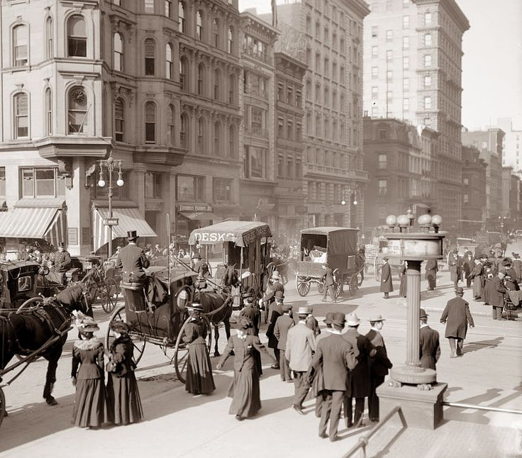 America's Gilded Age, in New York City, c.1900. Street view of, pedestrians, horse-drawn carts,  and hansom cabs, that are all congregated on a very congested Fifth Avenue. ~ {cwlyons}