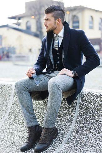Men's White Dress Shirt, Black Cardigan, Grey Wool Blazer, Navy Overcoat, Grey Wool Dress Pants, Dark Brown Leather Boots, and Grey Print Tie