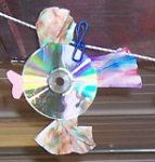 2 Old CDs Construction Paper Wiggle Eyes Craft Glue Yarn or Fishing Line Scissors