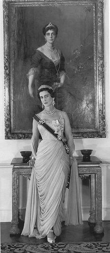 Princess Marina wearing the London fringe tiara, with her back to a portrait of her mother, Princess Elena fo Greece, herslf daughter of the Grand Duchess Vladimir of Russia