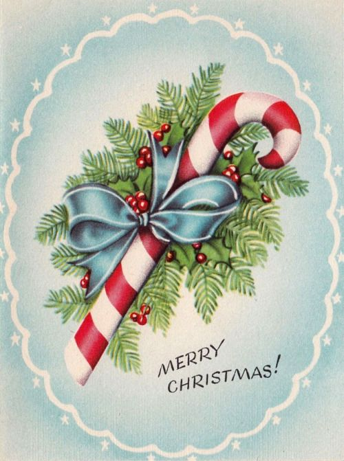 Vintage Christmas card with a candy cane and holly wrapped with a blue bow, on a soft blue background.