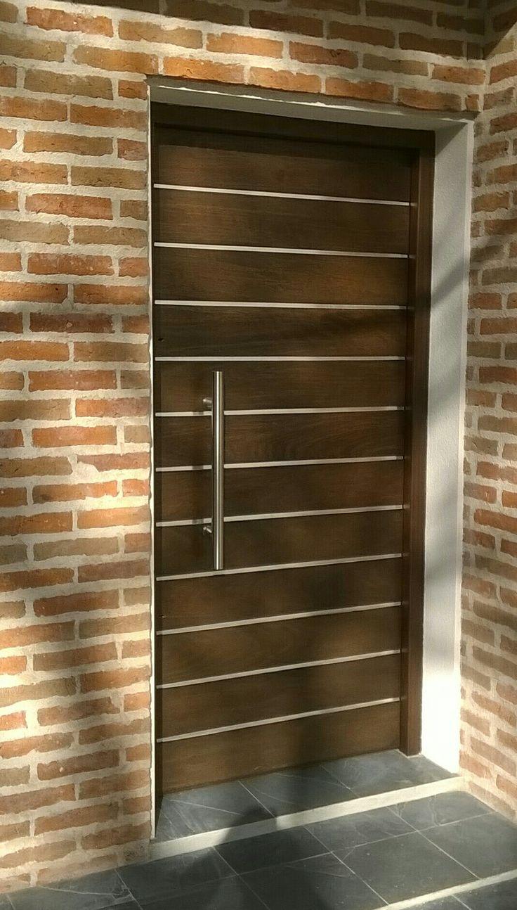 Puerta de apartamento al exterior marco de madera dura y for Tablas de madera para exterior