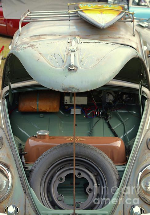 This 1958 Volkswagen Beetle Sports A Roof Rack Mounted Surfboard And Patina  With Pinstriping.