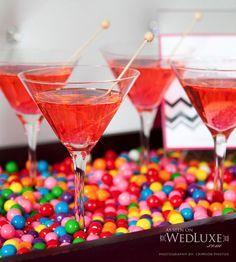 Bubblegum martinis! ~ served on a platter of, (what else?) gum balls! RECIPE FOR BUBBLEGUM MARTINIS: 2 oz. bubblegum flavoured vodka, 1 oz. ginger ale, 1 oz. cranberry juice. Shake with ice, strain into a chilled martini glass. Garnish.