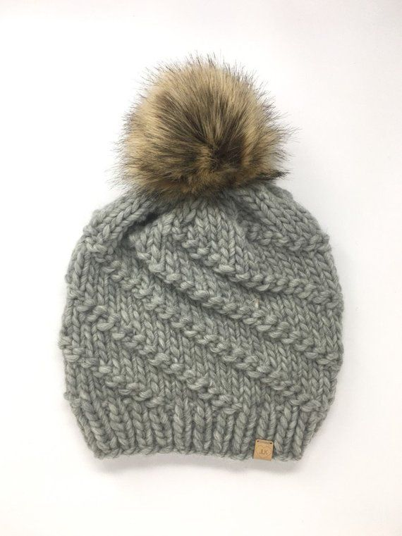 d1ecbeb162f Chunky light grey knit winter hat in spiral pattern with giant faux fur pom  pom