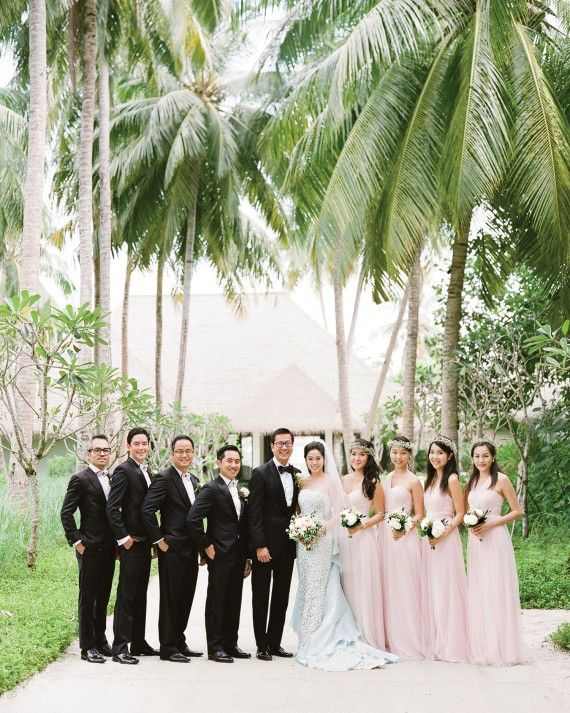 At this destination wedding in the Maldives, the bridal party wore simple Queen Anne's lace flower crowns and Jenny Yoo bridesmaids' dresses.