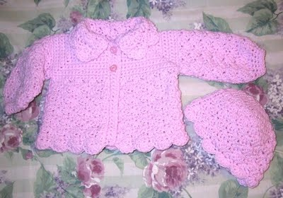 This is the sweater I started with for the pink one. The blanket is made like the dish clothes knitted from the corner using 3 different types of yarn on size 15 needles.