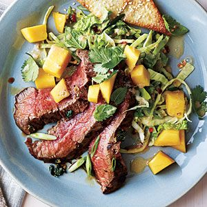 Grilled Asian Flank Steak with Mango Salad Recipe   MyRecipes.com (serve with sesame wanton crisps: http://www.myrecipes.com/m/magazines-and-cookbooks/cooking-light-recipes/cooking-light-may-2013-00420000019512/page2.html)