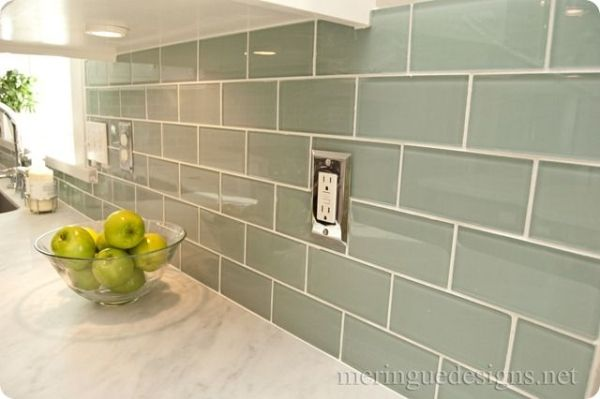 3x6 glass tile by Dal Tile in Whisper Green and Carrera Marble countertop by alyssa