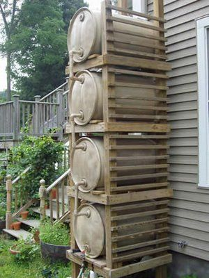 Collecting Rain for gardening. This system of rain barrels also provides water pressure.