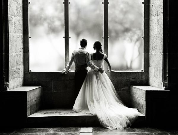 wedding picture in church window  photo from http://www.cuded.com/2013/03/50-creative-ideas-of-wedding-photography/
