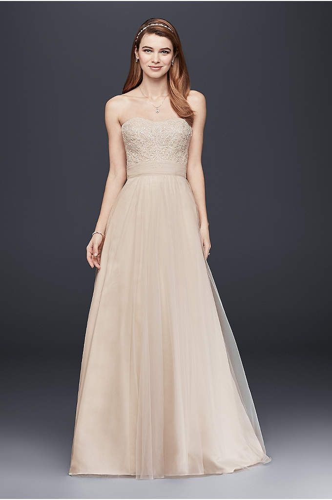 Effortlessly beautiful, this lace gown combines modern trends with classic elegance for a look that is drop-dead gorgeous. Sample Sale gowns are only available online (not available in stores). Samp